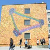 """Svjetski poznati umjetnik grafita-muralist Caleb Neelon predstavio je jučer u Sarajevu rad """"Murali mira"""", oslikan na fasadi jednog zida Veterinarskog fakulteta radi obilježavanja 20. godišnjice mira u BiH."""